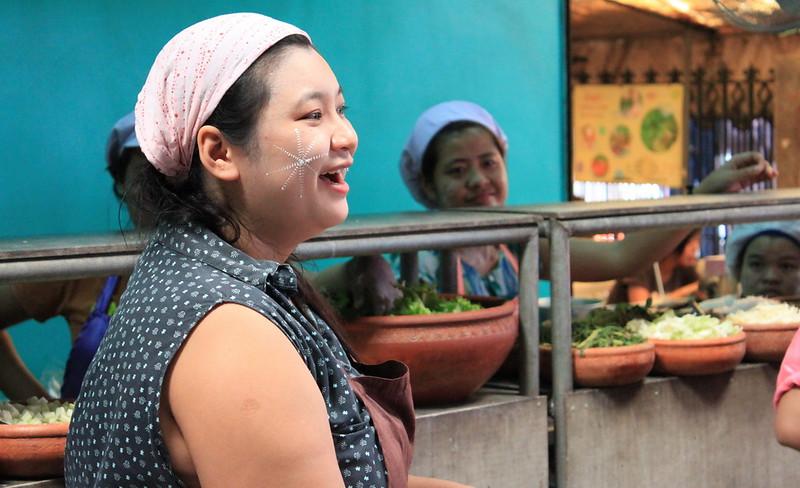 A vendor at a food shop