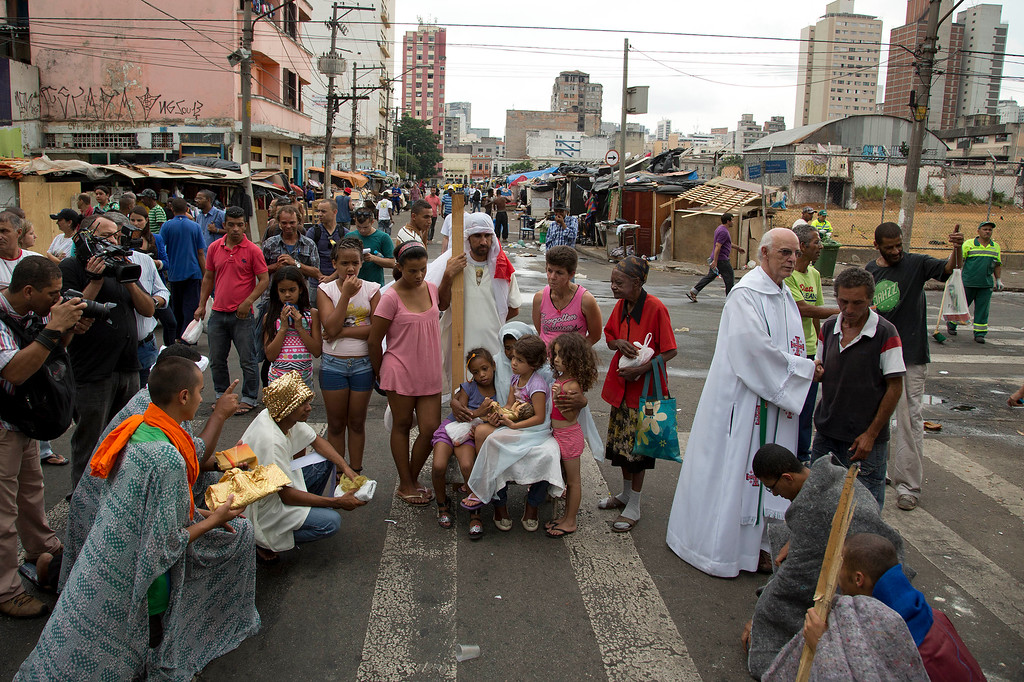 """. Church volunteers participate in a live nativity scene in a neighborhood popularly known as \""""Crackland\"""" in downtown Sao Paulo, Brazil, Wednesday, Dec. 25, 2013. (AP Photo/Andre Penner)"""