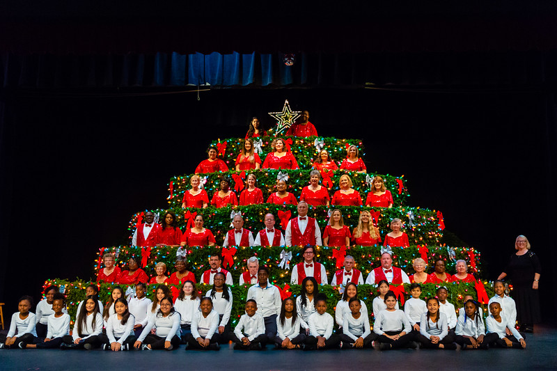 Members of the Living Christmas Tree Choir and the Young Singers of the Palm Beaches Choir in the Glades pose for a photo before the final performance of the Living Christmas Tree at the Dolly Hand Cultural Arts Center in Belle Glade on Sunday, December 2, 2018. [JOSEPH FORZANO/palmbeachpost.com]