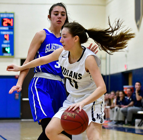 3/1/2019 Mike Orazzi | Staff Newington High School's Abygale Flores (21) and Glastonbury High School's Claire Scalise (3) during the Class LL Second Round of the CIAC 2019 State Girls Basketball Tournament at Newington High School Friday night.