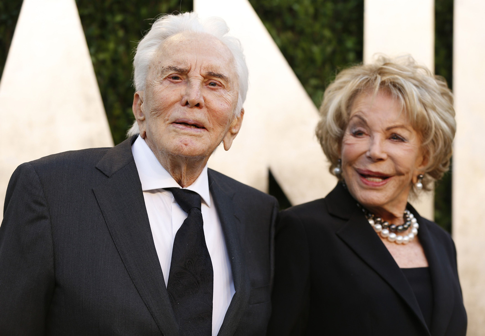 Description of . Kirk Douglas and wife Ann Buydens at the 2013 Vanity Fair Oscars Party in West Hollywood, California February 24, 2013.  REUTERS/Danny Moloshok