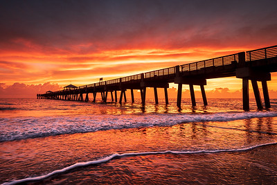 Sky lit up with beautiful color over the Juno Beach Pier