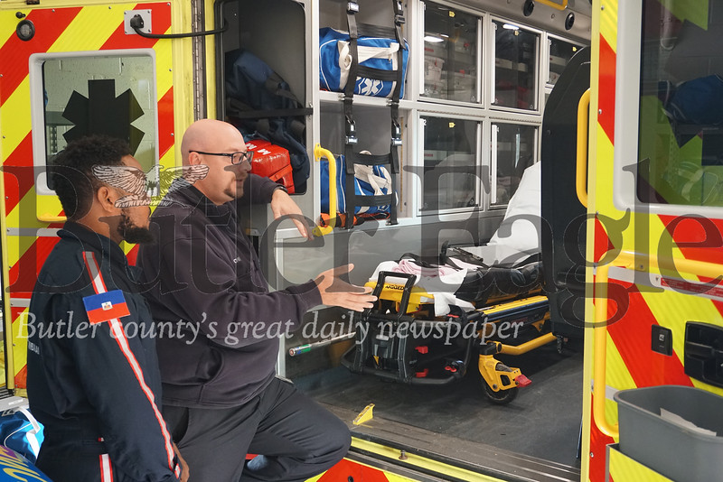 Photo by J.W. Johnson Jr. Cranberry Township EMS Chief and Executive Director Ted Fessides, right, shows Oberto Charles one of the organization's ambulances on Tuesday.