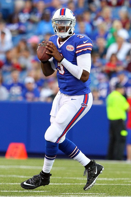 . Buffalo Bills quarterback EJ Manuel looks to pass against the Detroit Lions during the first half of a preseason NFL football game, Thursday, Aug. 28, 2014, in Orchard Park, N.Y. (AP Photo/Bill Wippert)