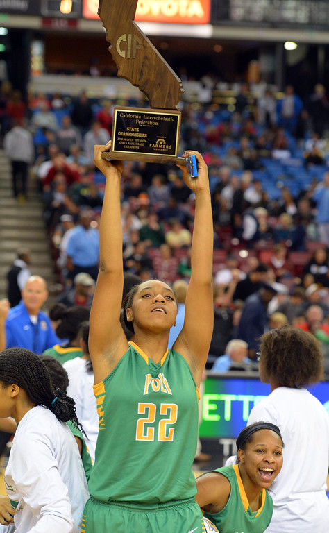 . Poly\'s Jada Matthews holds aloft their championship state trophy at Sleep Train Arena in Sacramento, CA on Saturday, March 29, 2014. Long Beach Poly vs Salesian in the CIF Open Div girls basketball state final. 2nd half. Poly won 70-52. (Photo by Scott Varley, Daily Breeze)