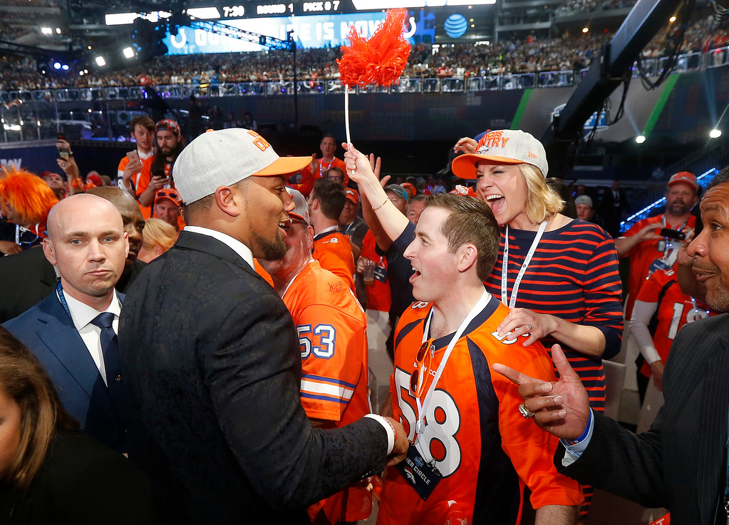 . North Carolina State\'s Bradley Chubb, center left, greets fans after being selected by the Denver Broncos during the first round of the NFL football draft, Thursday, April 26, 2018, in Arlington, Texas. (AP Photo/Michael Ainsworth)
