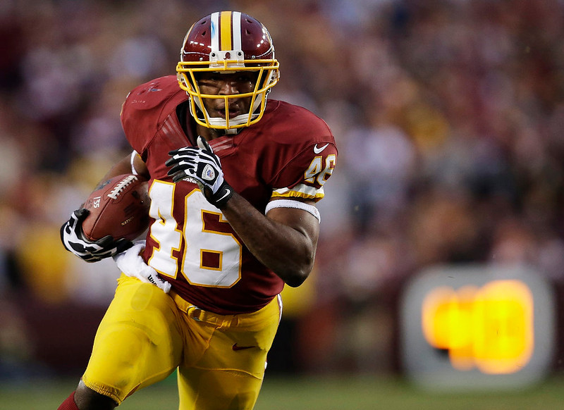 . Washington Redskins running back Alfred Morris carries the ball during the first half of an NFL wild card playoff football game against the Seattle Seahawks in Landover, Md., Sunday, Jan. 6, 2013. (AP Photo/Evan Vucci)