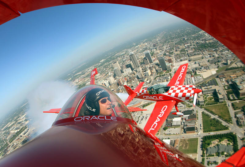Sean D. Tucker and his son Eric Tucker will fly the Oracle stunt planes for the Mount Comfort Air Show this coming weekend. Here Sean (foreground) and his son take a spin over Indy on their way to the Mount Comfort Airport Thursday afternoon, August 23, 2007. (Sam Riche / The Indianapolis Star)