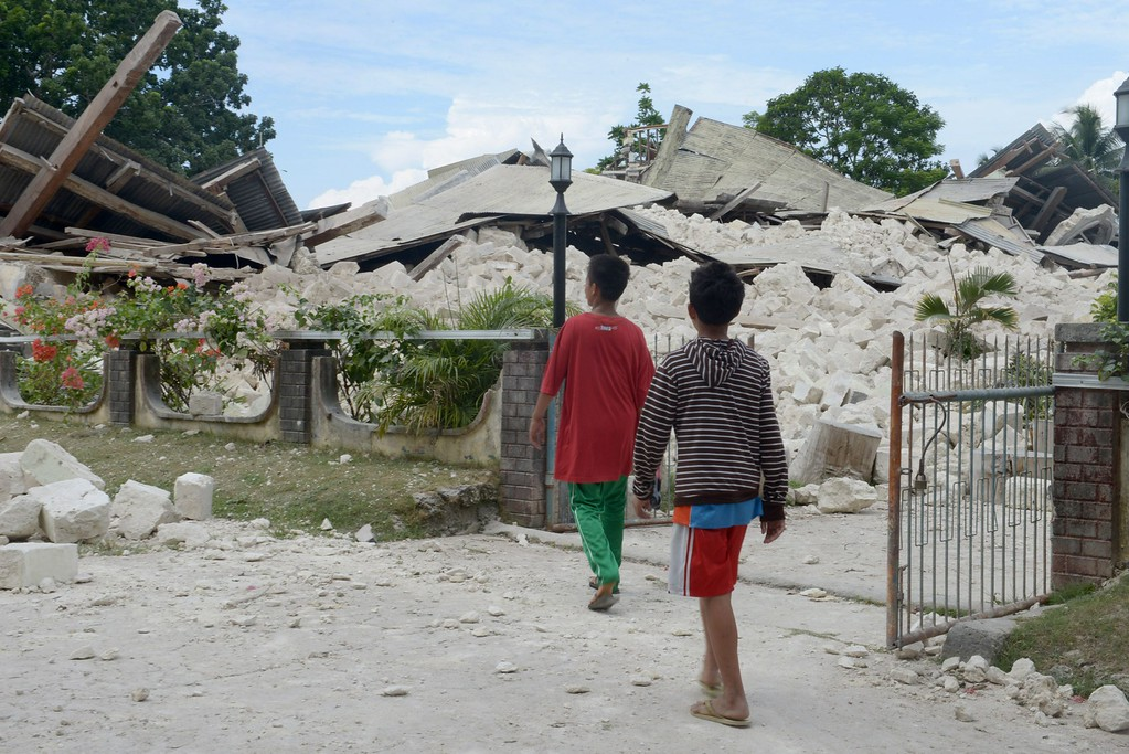 . Children look at the ruins of the 180 years old Our lady of light Church on the popular tourist island of Bohol, central Philippines on October 16, 2013 following a 7.1-magnitude earthquake in the area on October 15. AFP PHOTO / Jay DIRECTO/AFP/Getty Images