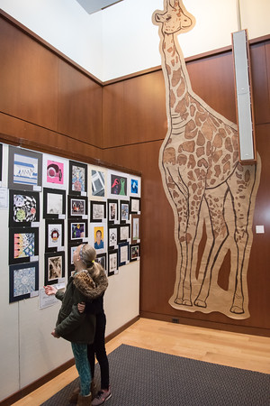 04/17/18 Wesley Bunnell | Staff Charley Carlson, age 10, and sister Shea Carlson, age 8, look over original art work created by Berlin Public School students during an opening reception on Tuesday night at the New Britain Museum of American Art.