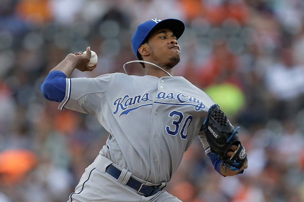. Kansas City Royals pitcher Yordano Ventura throws against the Detroit Tigers in the first inning of a baseball game in Detroit, Tuesday, June 17, 2014.  (AP Photo/Paul Sancya)