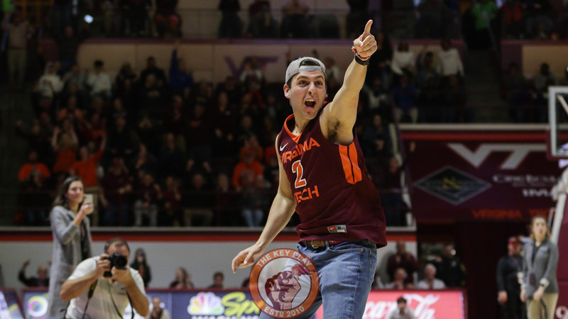 A student celebrates hitting a half court shot for $10,000 during a media timeout. (Mark Umansky/TheKeyPlay.com)