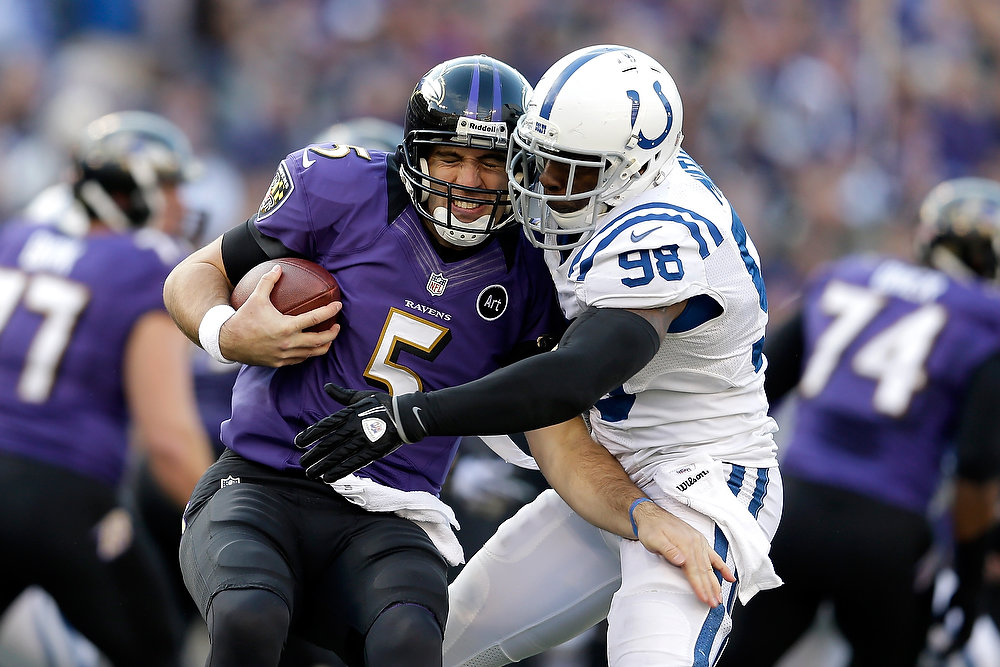 . Joe Flacco #5 of the Baltimore Ravens is sacked by Robert Mathis #98 of the Indianapolis Colts in the third quarter during the AFC Wild Card Playoff Game at M&T Bank Stadium on January 6, 2013 in Baltimore, Maryland.  (Photo by Rob Carr/Getty Images)