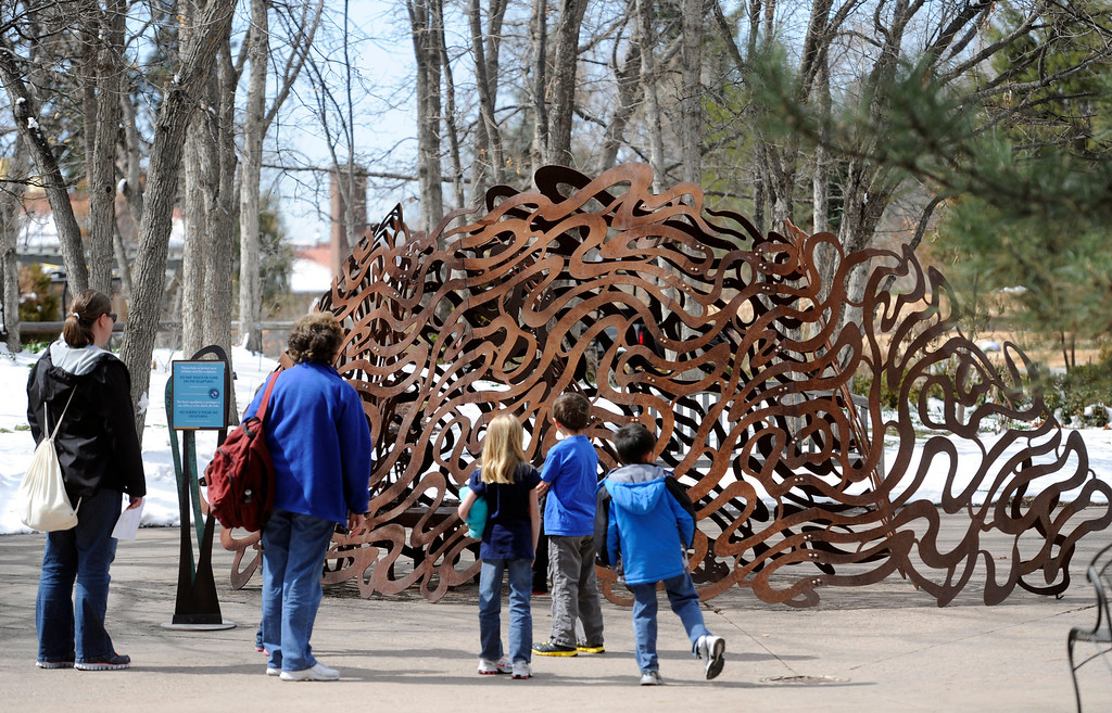 ". Visitors check out ""Refugium\"" by artist Linda Fleming. Artists and volunteers work on a new art installation, Catalyst: Colorado Sculpture at the Denver Botanic Gardens. (Photo By Kathryn Scott Osler/The Denver Post)"