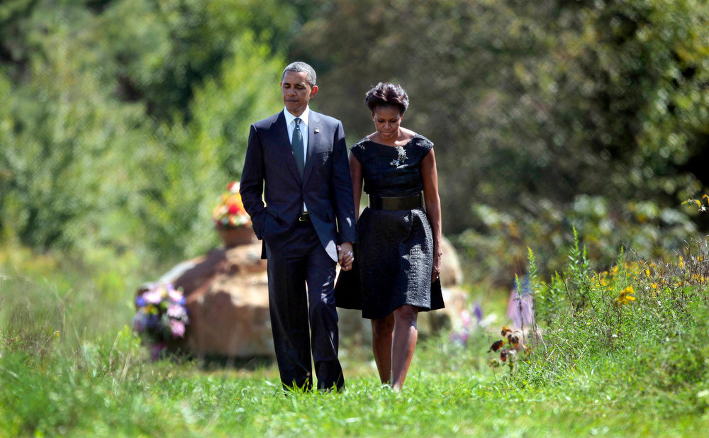 . President Barack Obama and first lady Michelle Obama walk away after visiting the crash site of Flight 93 during their visit to the Flight 93 National Memorial Sunday, Sept., 11, 2011, in Shanksville, Pa., on the 10th anniversary of Sept. 11. (AP Photo/Pablo Martinez Monsivais)