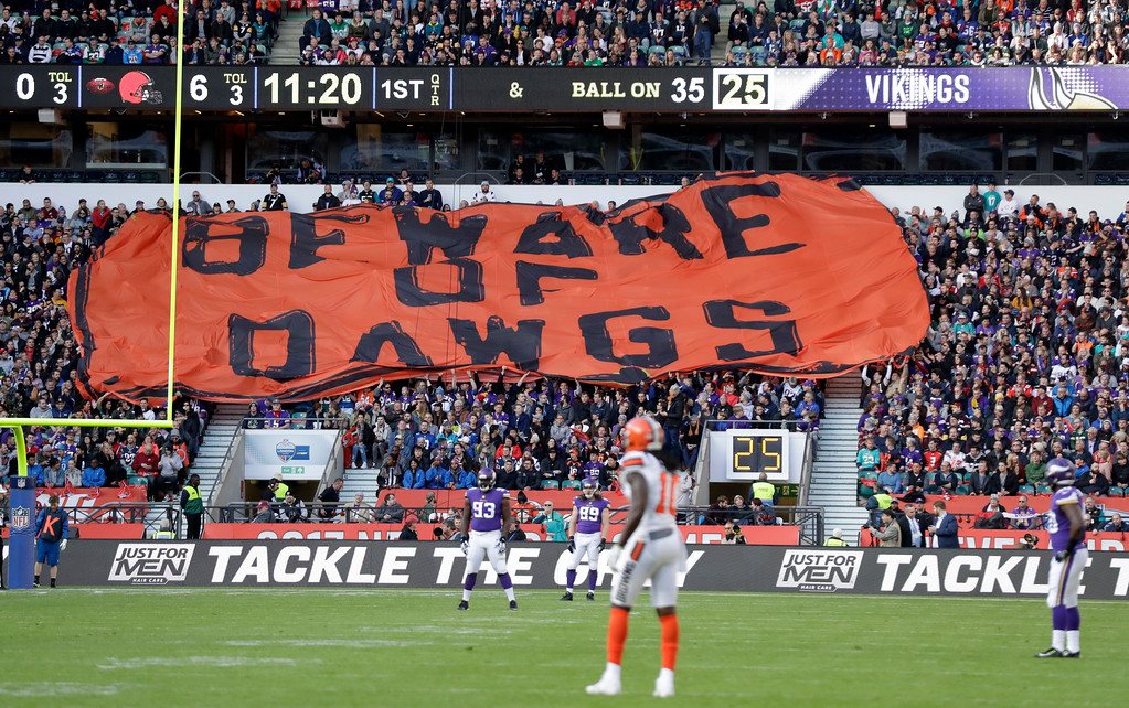 . Cleveland Browns supporters unfurl a giant banner during the first half of an NFL football game against Minnesota Vikings at Twickenham Stadium in London, Sunday Oct. 29, 2017. (AP Photo/Matt Dunham)