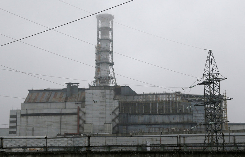 . The damaged reactor at the Chernobyl nuclear power plant in Chernobyl, Ukraine is seen Tuesday, Nov. 27, 2012. Workers on Tuesday raised the first section of a colossal arch-shaped structure that is eventually to cover the exploded reactor at the Chernobyl nuclear power station. Project officials on Tuesday hailed the raising as a significant step in a complex effort to liquidate the consequences of the world\'s worst nuclear accident, in 1986. (AP Photo/Efrem Lukatsky)