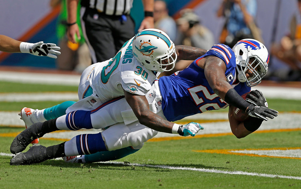 . Buffalo Bills running back Fred Jackson (22) stretches for a touchdown as Miami Dolphins strong safety Chris Clemons (30) defends during the first half of an NFL football game, Sunday, Oct. 20, 2013, in Miami Gardens, Fla. (AP Photo/Wilfredo Lee)