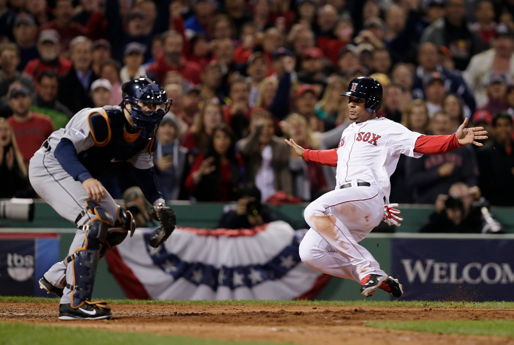 . Boston Red Sox\'s Xander Bogaerts, right, scores from second past Detroit Tigers catcher Alex Avila, left, on a hit by Jacoby Ellsbury in the fifth inning during Game 6 of the American League baseball championship series on Saturday, Oct. 19, 2013, in Boston. (AP Photo/Charles Krupa)