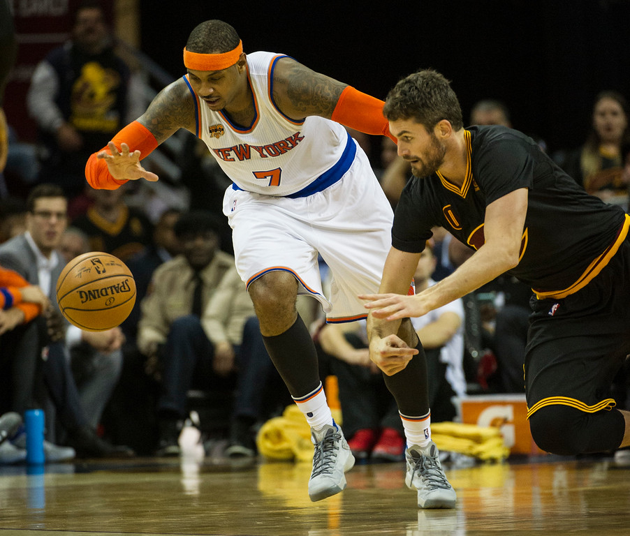 . New York Knicks\' Carmelo Anthony (7) beats Cleveland Cavaliers\' Kevin Love to the ball during the second half of an NBA basketball game in Cleveland, Tuesday, Oct. 25, 2016. (AP Photo/Phil Long)