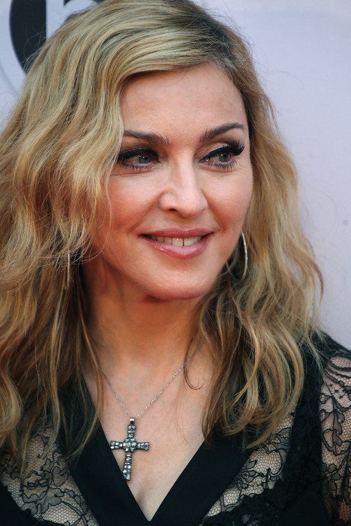 . U.S. singer Madonna poses at the opening of the new fitness club in Moscow, Russia, Monday, Aug. 6, 2012 (AP Photo/Mikhail Metzel)