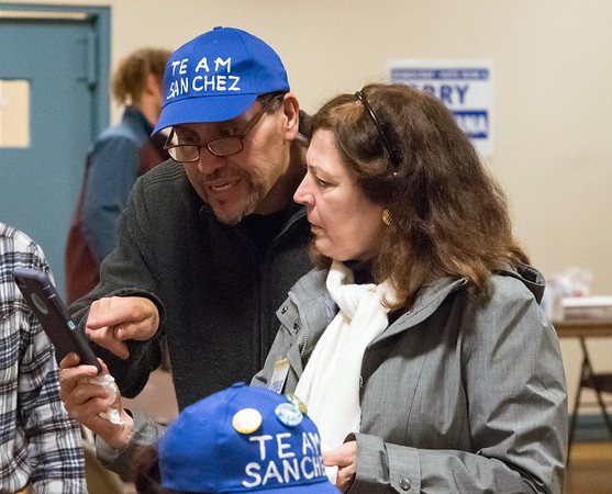 11/06/18 Wesley Bunnell | Staff Rep. Robert Sanchez looks over election night results late on Tuesday night along with Lanette Macaruso at the Pulaski Club which served as the Democratic headquarters.