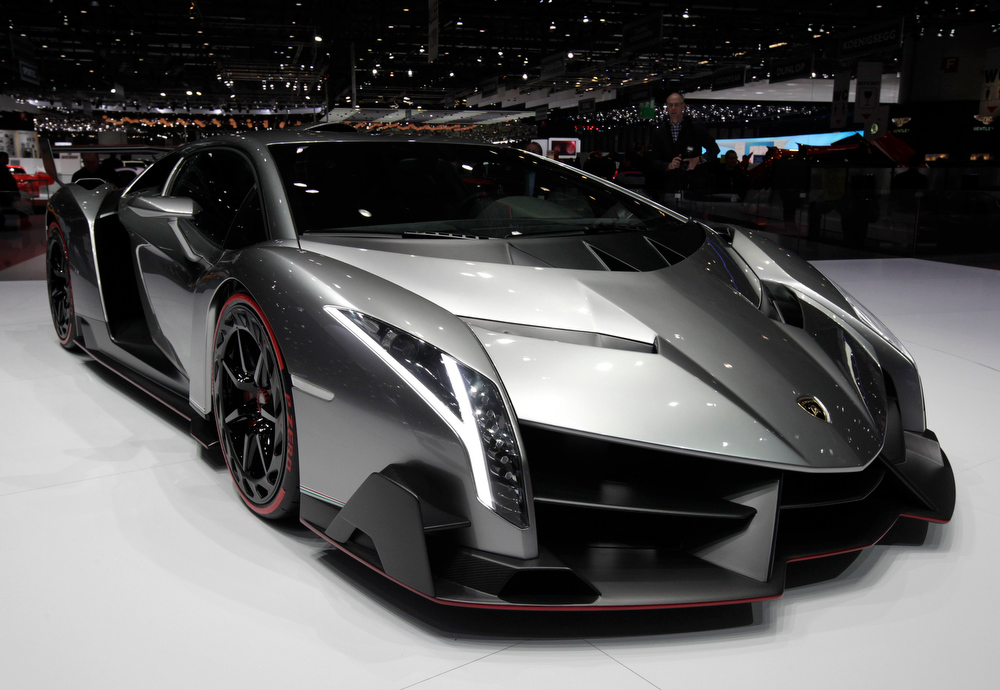 . The Veneno car is pictured on the Lamborghini booth during the second media day of the 83rd Geneva Car Show at the Palexpo Arena in Geneva March 6, 2013. The Geneva Motor Show will take place from March 7 to 17, 2013. REUTERS/Denis Balibouse