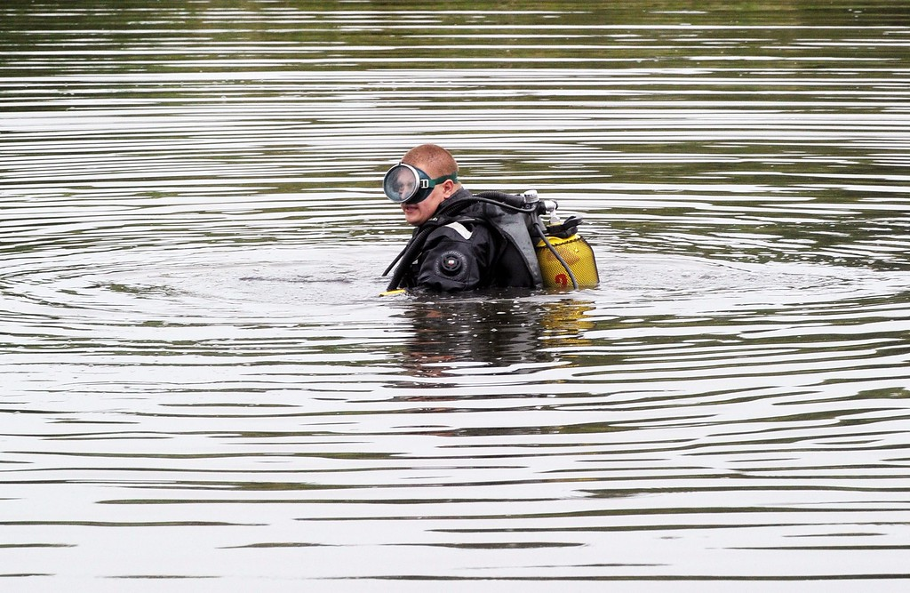 . A diver searches for a black box on July 18, 2014 on the site of the crash of a Malaysian airliner carrying 298 people from Amsterdam to Kuala Lumpur, near the town of Shaktarsk, in rebel-held east Ukraine. Pro-Russian separatists in the region and officials in Kiev blamed each other for the crash, after the plane was apparently hit by a surface-to-air missile. All 298 people on board Flight MH17 died when the plane crashed. AFP PHOTO/DOMINIQUE FAGET/AFP/Getty Images