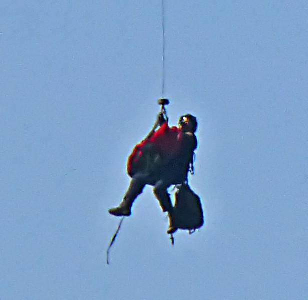 Mtn biker & Medic below helicopter