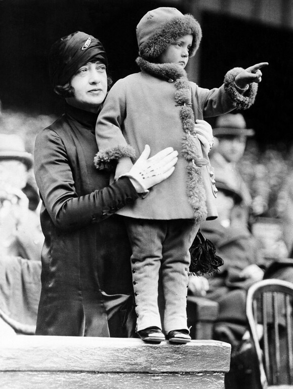 ". Mrs. George Herman Ruth, wife of ""Babe\"" Ruth, the Home-Run King was burned to death in a fire which destroyed a house at which she was visiting in Watertown, Mass. on Jan. 11, 1929.   Mrs. Ruth and her little daughter watching the Home Run King at one of the World Series games in an undated photo.   (AP Photo)"