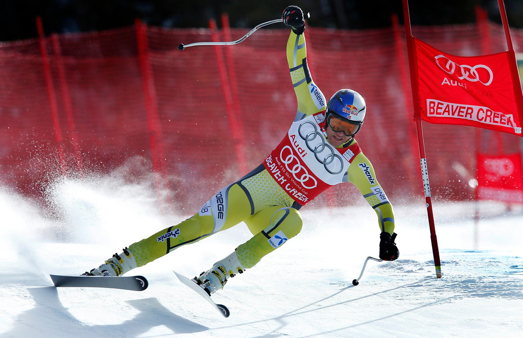 . World Cup overall points leader Aksel Lund Svindal of Norway skis past a gate in the men\'s World Cup downhill ski race in Beaver Creek, Colorado, November 30, 2012. Svindal finished second in the race. REUTERS/Mike Segar