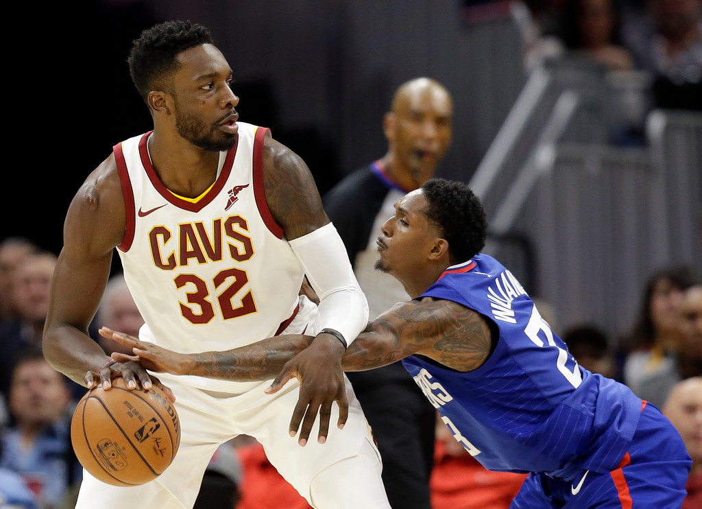 . Cleveland Cavaliers\' Jeff Green (32) tries to get past Los Angeles Clippers\' Lou Williams (23) in the second half of an NBA basketball game, Friday, Nov. 17, 2017, in Cleveland. The Cavaliers won 118-113 in overtime. (AP Photo/Tony Dejak)