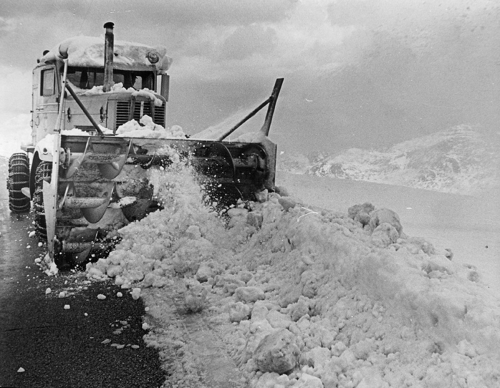 . A rotary plow cleans snow from the edge of Trail Ridge Road in Rocky Mountain National Park near the highest point on highway, 12,183 feet in 1968. (Denver Post Library photo archive)