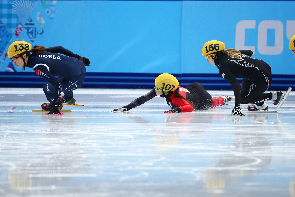 . Valerie Maltais (C) of Canada falls while competing in the Short Track Women\'s 1000m Semifinals on day fourteen of the 2014 Sochi Winter Olympics at Iceberg Skating Palace on February 21, 2014 in Sochi, Russia.  (Photo by Ryan Pierse/Getty Images)