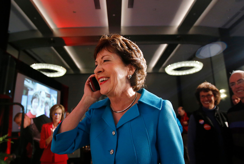 . Sen. Susan Collins, R-Maine takes a congratulatory phone call from President Barack Obama after her re-election victory over Democrat Shenna Bellows, Tuesday, Nov. 4, 2014, in Portland, Maine. (AP Photo/Bill Sikes)