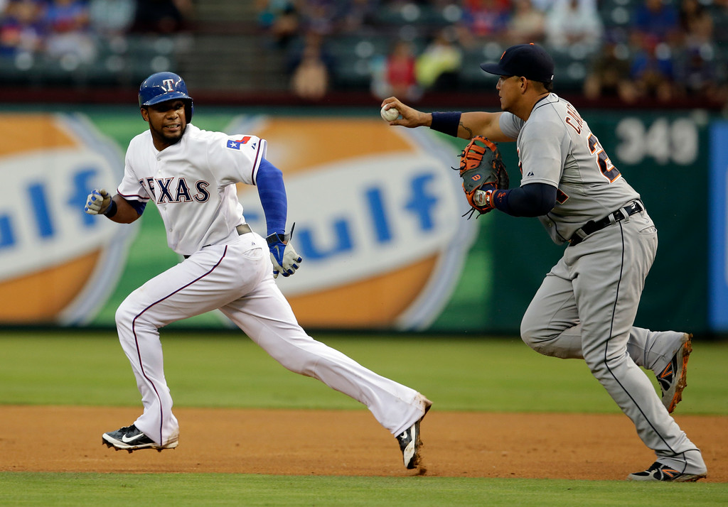 . Texas Rangers\' Elvis Andrus attempts to evade a tag by Detroit Tigers\' Miguel Cabrera, right, in the first inning of a baseball game, Tuesday, June 24, 2014, in Arlington, Texas. Andrus was tagged out attempting to steal second. (AP Photo/Tony Gutierrez)
