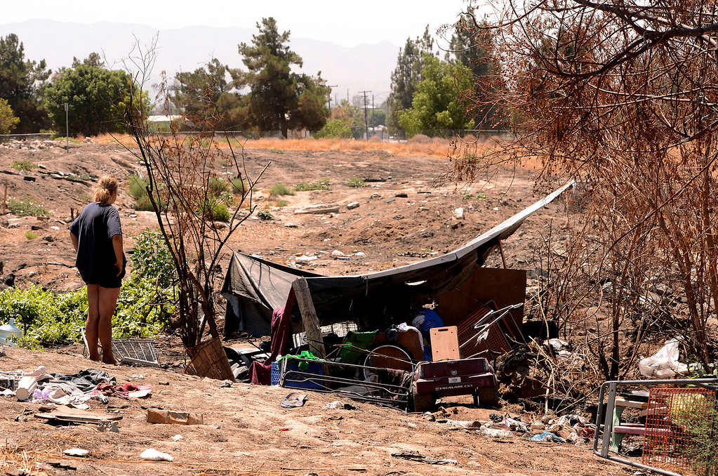 . Donna Bonner, 30, stands outside the homeless camp she\'s been living at in San Bernardino August 14, 2013. GABREL LUIS ACOSTA/STAFF PHOTOGRAPHER.