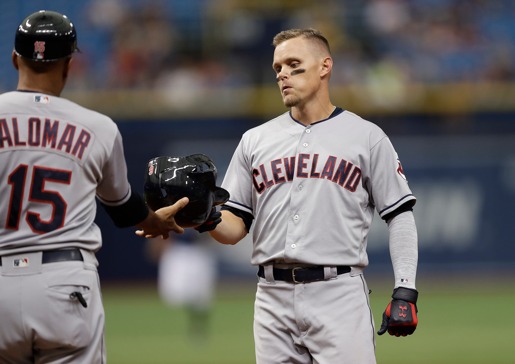 . Cleveland Indians\' Brandon Guyer, right, hands his helmet to first base coach Sandy Alomar Jr. after flying out to Tampa Bay Rays right fielder Mallex Smith during the fourth inning of a baseball game Wednesday, Sept. 12, 2018, in St. Petersburg, Fla. (AP Photo/Chris O\'Meara)