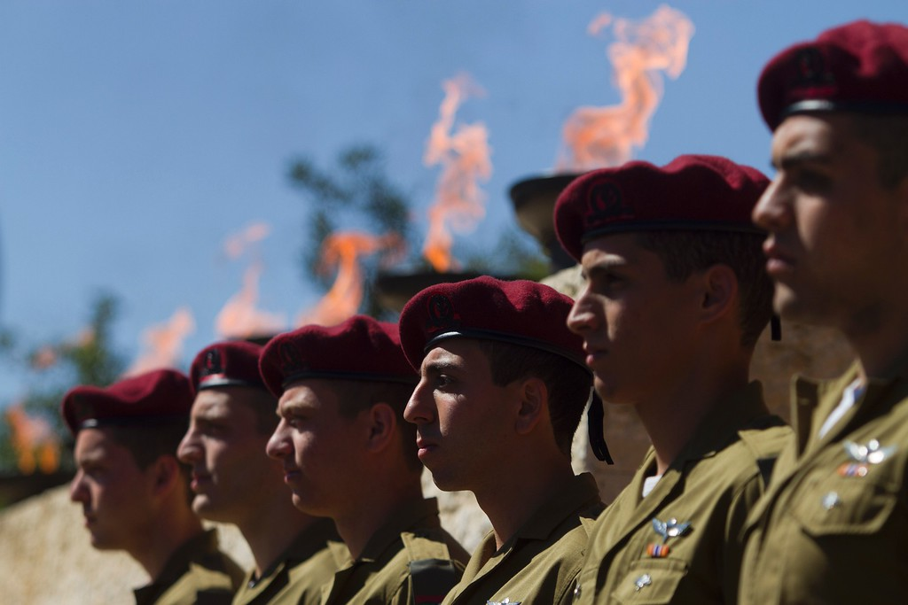 . Israeli Soldiers stand at attention during a ceremony marking the annual Holocaust Remembrance Day at the Yad Vashem Holocaust Memorial in Jerusalem on May 5, 2016. Israelis have stopped in their tracks, standing in silence as sirens pierced the air to remember the 6 million Jews who perished in the Nazi Holocaust during World War II. / AFP PHOTO / POOL/AFP/Getty Images