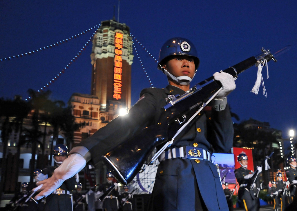 . Taiwanese soldiers take part in a flag-raising ceremony at the Presidential Office Square in Taipei on January 1, 2014.   Thousands of people attended the event on New Year\'s Day to celebrate the 103rd anniversary of the founding of the Republic of China.  Mandy Cheng/AFP/Getty Images