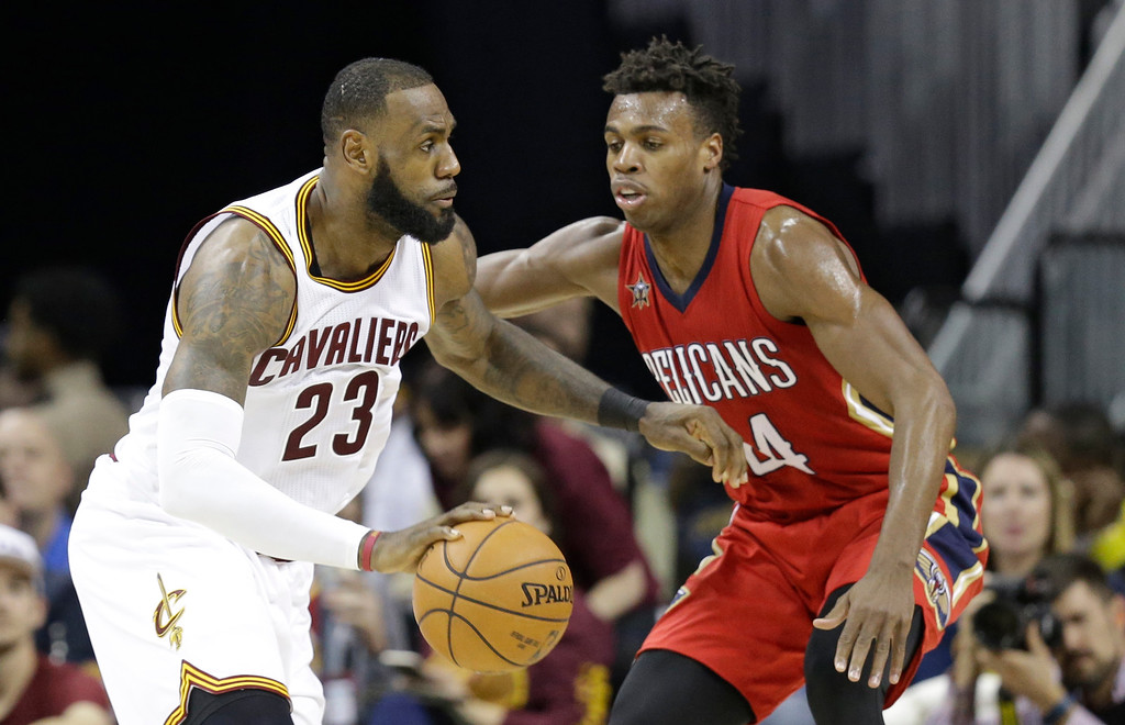 . Cleveland Cavaliers\' LeBron James (23) drives against New Orleans Pelicans\' Buddy Hield (24), from Bahamas, in the second half of an NBA basketball game, Monday, Jan. 2, 2017, in Cleveland. (AP Photo/Tony Dejak)