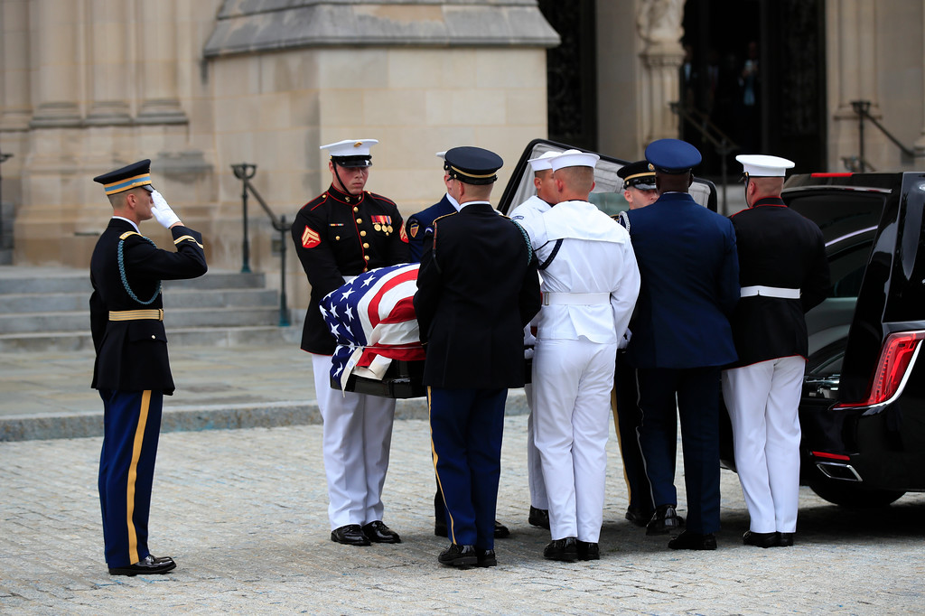 . Military Honor guards place the casket of Sen. John McCain, R-Ariz., into a hearse, following a memorial service at the Washington National Cathedral in Washington, Saturday, Sept. 1, 2018. (AP Photo/Manuel Balce Ceneta)