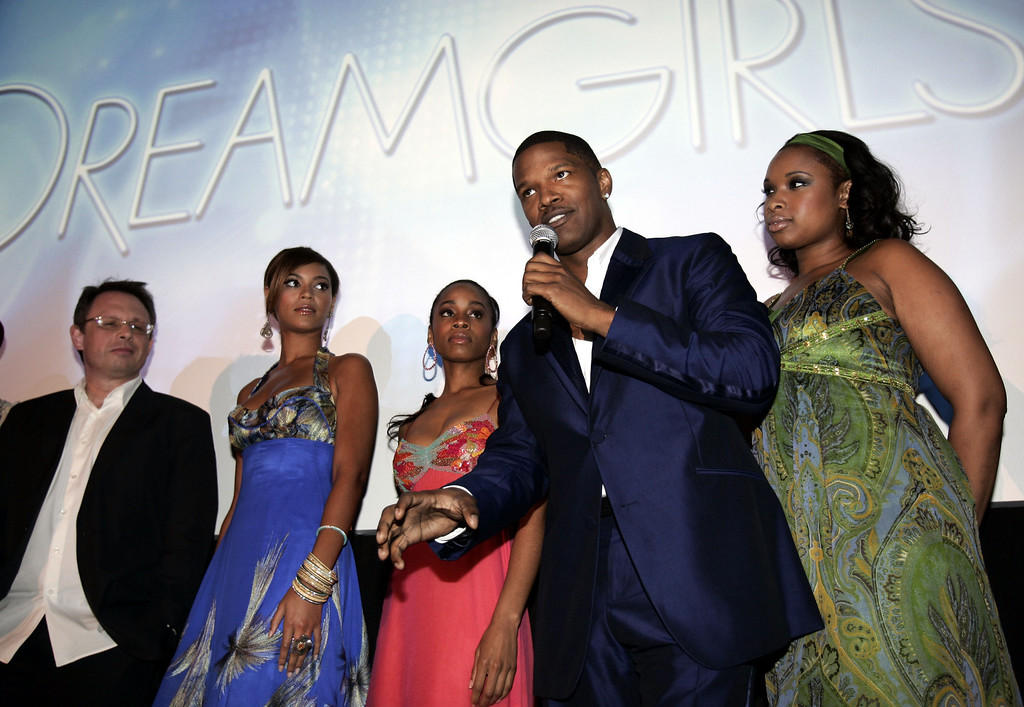 ". Actor Jamie Foxx, second from right, speaks following a preview of the new film ""Dreamgirls,\"" as director Bill Condon, left, actress Beyonce Knowles, second from left, actress Anika Noni Rose, third from left, and actress Jennifer Hudson look on in Cannes, southern France, Friday, May 19, 2006. The film will be released during the holiday season in the United Sates.  (AP Photo/Jeff Christensen)"