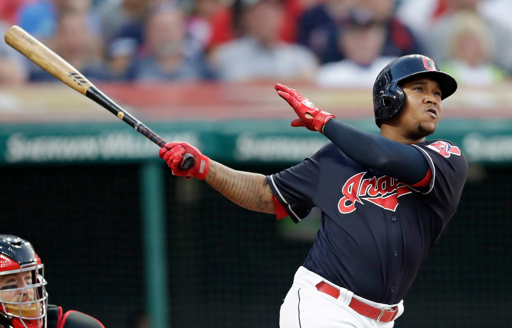 . Cleveland Indians\' Jose Ramirez watches his ball after hitting a three-run home run off Cincinnati Reds relief pitcher Tanner Rainey in the third inning of a baseball game, Wednesday, July 11, 2018, in Cleveland. Francisco Lindor and Michael Brantley scored. (AP Photo/Tony Dejak)