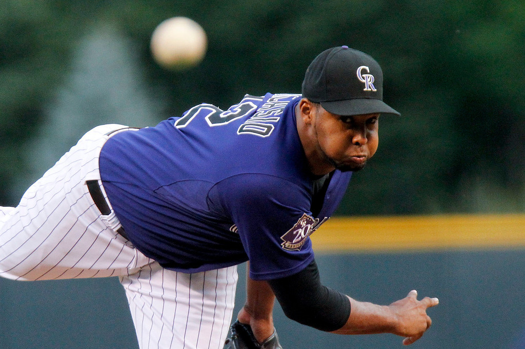 . Colorado Rockies starting pitcher Juan Nicasio challenges San Francisco Giants\' Gregor Blanco (7) during the first inning of a baseball game, Monday, Aug. 26, 2013, in Denver. (AP Photo/Barry Gutierrez)