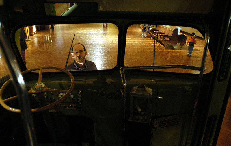 . Henry Ford Museum member Mark Schneider looks at the bus in which civil-rights icon Rosa Parks refused to give up her seat in 1955, Friday, Jan. 31, 2003, in Dearborn, Mich. The museum unveiled the bus Friday for 300 of its members and will open the display to all museum goers on Saturday, the first day of Black History Month. The museum purchased the bus in October 2001 for $492,000 after it was found in a field in Alabama. (AP Photo/John F. Martin)