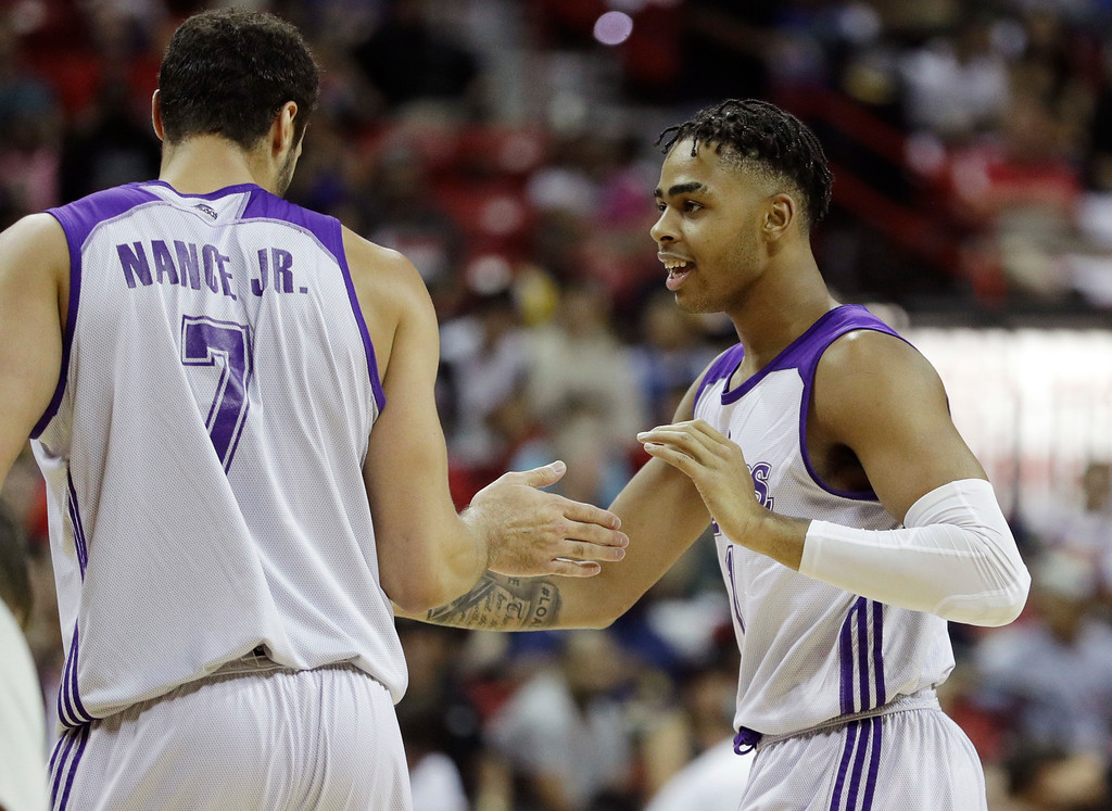 . Los Angeles Lakers\' D\'Angelo Russell, right, celebrates with Larry Nance Jr. after a play against the Cleveland Cavaliers during the first half of an NBA summer league basketball game, Thursday, July 14, 2016, in Las Vegas. (AP Photo/John Locher)