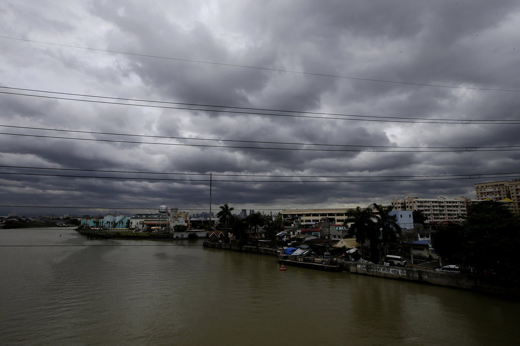 . Rain clouds loom over the horizon in Manila, Philippines Tuesday, Aug. 13, 2013, a day after powerful Typhoon Utor battered northeastern Philippines that toppled power lines and dumped heavy rain across mountains, cities and food-growing plains. The storm left at least two people dead and 44 missing. Typhoon Utor, described as the strongest globally this year, slammed ashore in mountainous eastern Aurora province with sustained winds of 175 kilometers (109 miles) per hour and gusts of up to 210 kph (130 mph). (AP Photo/Bullit Marquez)