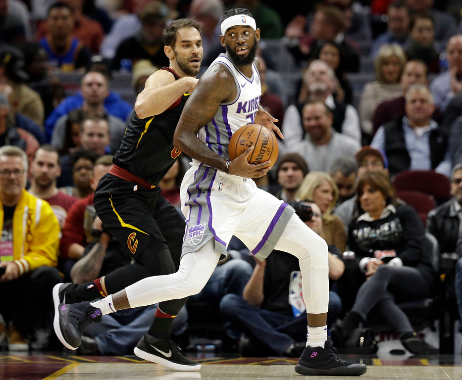 . Sacramento Kings\' JaKarr Sampson, right, drives past Cleveland Cavaliers\' Jose Calderon, from Spain, in the first half of an NBA basketball game, Wednesday, Dec. 6, 2017, in Cleveland. (AP Photo/Tony Dejak)