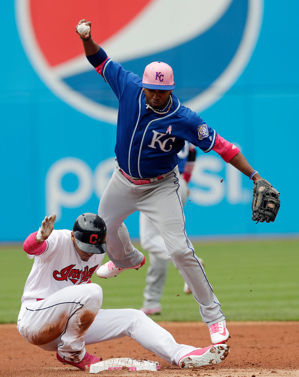 . Kansas City Royals\' Alcides Escobar, top, gets Cleveland Indians\' Erik Gonzalez out at second base in the second inning of a baseball game, Sunday, May 13, 2018, in Cleveland. Escobar was not able to make the throw to first base to get Greg Allen for the double play. (AP Photo/Tony Dejak)